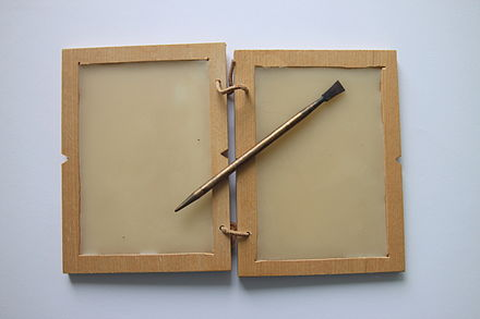 Wax tablet and a Roman stylus Table with was and stylus Roman times.jpg