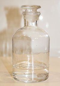 Photograph of a glass bottle of tetrahydrofuran