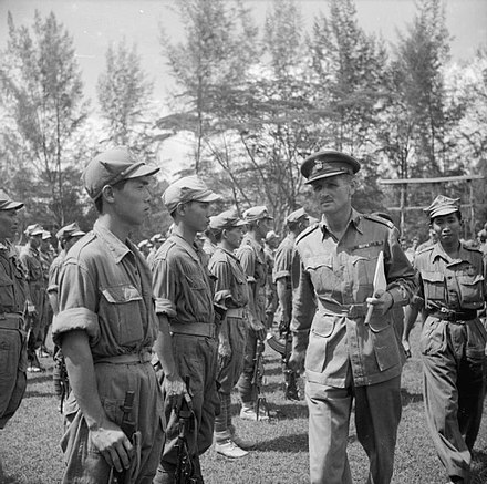 British Brigadier J J McCully inspects men of the 4th Regiment of the MPAJA guerrillas at Johor Bahru after the end of war in 1945. The British Reoccupation of Malaya SE5882.jpg