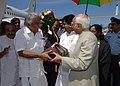 The Chief Minister, Kerala, Shri Oommen Chandy presenting the memento to the Vice President, Shri Mohd. Hamid Ansari, at Technical Airport, Thiruvanathapuram on February 17, 2013.jpg