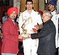 The President, Shri Pranab Mukherjee presenting the Arjuna Award for the year-2016 to Shri Gurpreet Singh for Shooting, in a glittering ceremony, at Rashtrapati Bhavan, in New Delhi on August 29, 2016.jpg