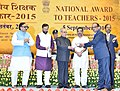 The President, Shri Pranab Mukherjee presenting the National Award for Teachers-2015 to Shri Valand Pravin Kumar Maganlal (Dadar & Nagar Haveli), on the occasion of the 'Teachers Day', in New Delhi.jpg
