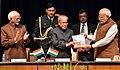 """The Prime Minister, Shri Narendra Modi presenting the first copy of a book entitled """"Rashtrapati Bhavan Raj to Swaraj"""" to the President, Shri Pranab Mukherjee, at Rashtrapati Bhavan, in New Delhi.jpg"""