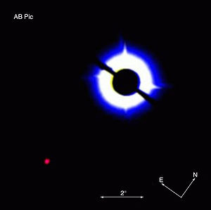 Exoplanet - Coronagraphic image of AB Pictoris showing a companion (bottom left), which is either a brown dwarf or a massive planet. The data was obtained on 16 March 2003 with NACO on the VLT, using a 1.4 arcsec occulting mask on top of AB Pictoris.