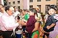 The Union Minister for Health and Family Welfare, Dr. Harsh Vardhan being welcomed by small children, at All India Institute of Speech and Hearing, in Mysore, Karnataka on October 17, 2014.jpg