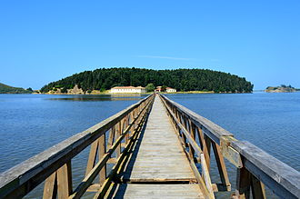 Vjosa-Narta Protected Landscape - A wooden footbridge connects mainland to the island