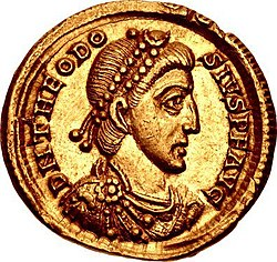 Golden coin depicting man facing right