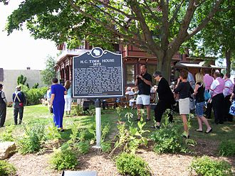 Herman C. Timm House - Road sign and rededication crowd