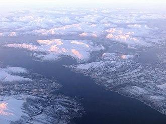 Tjeldsund - Aerial view over Tjeldsund and part of Ofotfjord in January. Tjeldsund is partly located on the mainland, but also includes Tjeldøya (island).