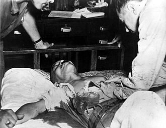 Japanese general Hideki Tojo, receiving treatment immediately after attempted suicide, 1945 Tojo suicide.jpg