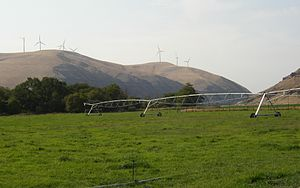 Tucannon River - Agriculture in the Tucannon River Valley. Wind turbines line the ridge above.