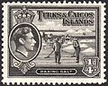 Turks and Caicos Islands raking salt stamp 1938.jpg