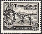 Turks and Caicos Islands raking salt stamp 1938.jpg