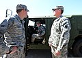 U.S. Air Force Airman 1st Class Travis Townsend, left, and Staff Sgt. Ethan Chandler, center, both with the 137th Air Refueling Wing security force, talk with Army Capt. David Jordan, a chaplain with Alpha 130522-Z-TK779-006.jpg