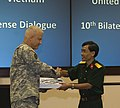 U.S. Army Brig. Gen. Burdett K. Thompson, left, deputy director for Strategic Planning and Policy, U.S. Pacific Command, presents a gift to a Vietnamese army officer with the Vietnam Ministry of National Defense 130815-N-JZ251-062.jpg