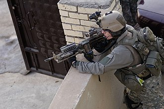 Rail system (firearms) - A U.S. Army Ranger, armed with a M249 light machine gun, Showing multiple Rails and Accessories in overwatch security on an objective during a mission in Iraq, 2006.