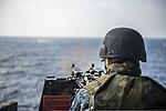 U.S. Navy Electronics Technician 3rd Class Dillon Fair fires an M240B machine gun during a live-fire exercise aboard the amphibious transport dock ship USS Denver (LPD 9) March 10, 2014, in the East China Sea 140310-N-ZU025-131.jpg