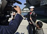 U.S. Navy Machinist's Mate 3rd Class Andrew Kim speaks to reporters after a news conference near the aircraft carrier USS George Washington (CVN 73) in Busan, South Korea, Oct. 4, 2013 131004-N-TB410-011.jpg