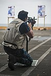U.S. Navy Master-at-Arms 2nd Class Matthew Sturgis fires an M4 carbine during a live-fire exercise aboard the aircraft carrier USS Harry S. Truman (CVN 75) in the Gulf of Aden Aug. 25, 2013 130825-N-DV340-033.jpg
