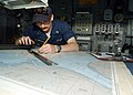 US Navy 020627-N-4374S-007 Quartermaster plots ship's position on the bridge.jpg