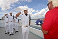 US Navy 020903-N-3228G-007 Sailors assigned to the Ceremonial Guard for Navy Region Hawaii salute as the National Ensign is presented during an internment servicethe son of a Navy.jpg