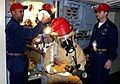 US Navy 030709-N-4928M-005 Senior Chief Damage Controlman James Osborne observes firefighters and damage control training team member, Chief Damage Controlman Jim Atooli during a training exercise aboard the amphibious assault.jpg