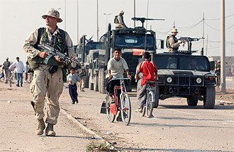 US Marines patrol the streets of Al Faw, October 2003. US Navy 031016-N-3236B-043 A marine patrols the streets of Al Faw, Iraq.jpg