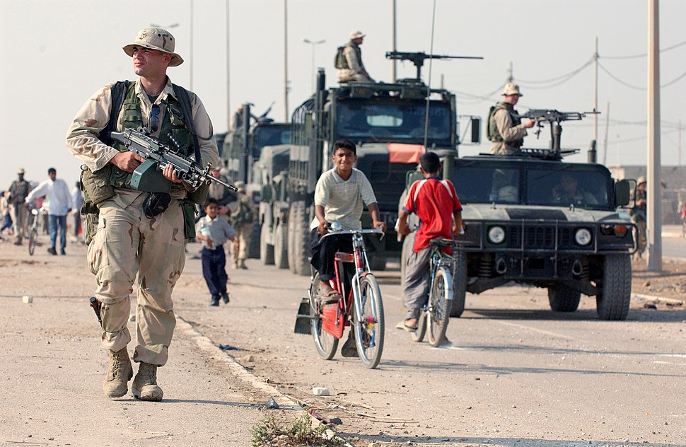 US Navy 031016-N-3236B-043 A marine patrols the streets of Al Faw, Iraq
