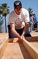US Navy 040623-N-8252B-067 Airman Apprentice Grant Griffith, from Seattle, Wash., assigned to the Nimitz-class aircraft carrier USS Ronald Reagan (CVN 76), builds a wall.jpg