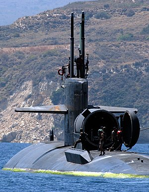 Dry deck shelter - USS Dallas (SSN-700) departs Souda Bay harbor with dry deck shelter attached in 2004.
