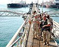US Navy 040821-N-0401E-039 Master Chief Petty Officer of the Navy (MCPON) Terry Scott and Sgt. Maj. of the Marine Corps John Estrada receive a tour of Al Basrah Oil Terminal, off the coast of Iraq.jpg