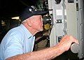 US Navy 041206-N-5539C-001 Pearl Harbor survivor, Woody Derby, takes a look through the periscope aboard the Los Angeles-class attack submarine USS Buffalo (SSN 715) during a tour of the submarine.jpg