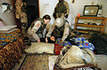 US Navy 050215-N-5319A-013 U.S Army Soldiers assigned to the 2nd Brigade Combat Team (BCT), 10th Mountain Division, render aid to a local Iraqi women who fainted as the 2nd BCT proceeds to conduct a search of her home during a.jpg