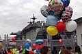 US Navy 050406-N-2970T-029 Friends and family await their Sailors and Marines to disembark at the homecoming celebration of the amphibious assault ship USS Essex (LHD 2).jpg