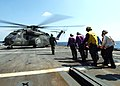 US Navy 050508-N-4374S-003 Stretcher bearers assigned to the amphibious transport dock ship USS Trenton (LPD 14), carry an 83-year old civilian, to an MH-53E Sea Dragon helicopter.jpg
