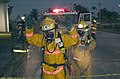 US Navy 050513-N-7293M-068 U.S. Air Force Staff Sergeant Anthony Iusi, back left, of Andersen Air Force Base's 36th Communication Squadron's multimedia team, films Federal Fire Fighters washing-down one of their fellow firefigh.jpg