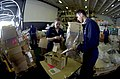 US Navy 050530-N-6781S-051 Machinist Mate 1st Class Louis Vasconez and Store Keeper 2nd Class Mari Cragun prepare supplies for distribution during a vertical replenishment.jpg