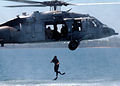 US Navy 050819-N-0716S-006 A Sailor assigned to Explosive Ordnance Disposal Mobile Unit Three (EODMU-3), Detachment 7, jumps from an MH-60S Seahawk helicopter during helo-cast operations.jpg