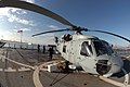 US Navy 060202-N-5334H-052 A SH-60B Seahawk Helicopter embarked aboard the command ship USS Blue Ridge (LCC 19), receives maintenance during the ship's port visit to Nagoya, Japan.jpg