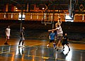 US Navy 070117-N-4965F-003 Chief Information Systems Technician Eddie Granger assigned to the Oliver Hazard Perry-class guided missile frigate USS Crommelin (FFG 37), drives toward the net to score a basket during a three-on-th.jpg