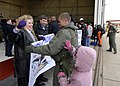 US Navy 081202-N-8933S-064 Aviation Warfare Systems Operator 2nd Class Aaron Stagg greets his family during a homecoming ceremony.jpg