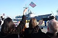 US Navy 090206-N-4049C-011 Friends and family await the return of the guided-missile frigate USS Taylor (FFG 50) as it arrives home from a successful six-month deployment.jpg