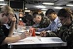 US Navy 090305-N-3589B-039 Sailors take the E-6 advancement exam aboard the nuclear-powered aircraft carrier USS Nimitz (CVN 68).jpg