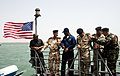 US Navy 090325-N-6590M-003 Lt. Allen Maxwell, third from left, commanding officer of the coastal patrol craft USS Chinook (PC 9), speaks with senior-level Iraqi officers during a port visit to Umm Qasr, Iraq.jpg