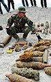 US Navy 090325-N-7130B-070 Chief Explosive Ordnance Disposal Technician Kenneth Simpson, assigned to Joint Special Operations Task Force-Philippines Explosive Ordnance Disposal Task Unit, inspects ordnance before a scheduled or.jpg