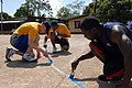 US Navy 090402-N-4143O-002 Lt. j.g. Gus Bennett, left, Electronics Technician 2nd Class Jason Hatton and Operations Specialist 2nd Class Mike McMurry repaint the lines on a basketball court during a Southern Partnership Station.jpg