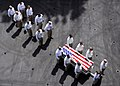 US Navy 090622-N-6854D-001 Chief petty officers assigned to Carrier Air Wing (CVW) 7 carry the casket of Command Master Chief Jeffrey J. Garber.jpg