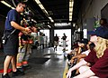 US Navy 090717-N-2456S-002 Firefighters Kris Hudgens, left, and David Fox, both assigned to the Navy Region Mid-Atlantic Fire and Emergency Services, demonstrate the different features of firefighting gear to students.jpg