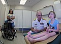 US Navy 091007-N-6220J-014 ear Adm. Bill Goodwin, Assistant Chief of Naval Operations for the Next Generation Enterprise Network, visits a young patient at Shriners Hospital for Children during a Caps For Kids event in Greenvil.jpg
