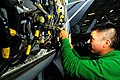 US Navy 091111-N-4053P-001 Aviation Electronics Technician 3rd Class Randy Whitehorse troubleshoots equipment on an F-A-18C Hornet.jpg